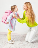 Mother helps her daughter get ready for school Stock Photo