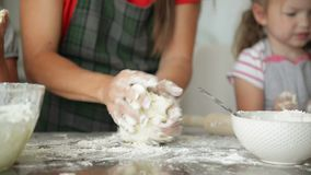 Mother Helps Her Daughter Knead the Dough. They Have a Lot of Fun Together. stock video footage