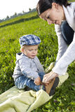 Mother helps her son Stock Photography