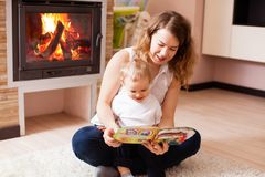 Mother helps her son to learn something new. Mother is reading for her son and both of them are happy royalty free stock photography