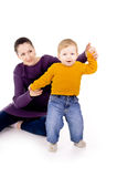 Mother helps to do the first steps of the child. On white background Royalty Free Stock Photography
