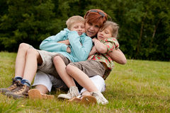 Mother and her 2 kids Royalty Free Stock Images
