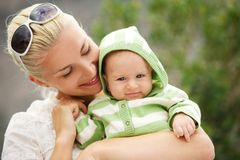Mother with her adorable baby outdoor Stock Photography