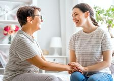 Mother and her adult daughter stock photography