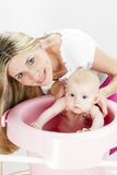 Mother with her baby during bathing Royalty Free Stock Images
