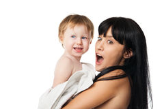 Mother with her baby after bathing in white towel Stock Photo