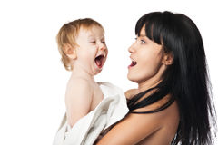 Mother with her baby after bathing in white towel Royalty Free Stock Images