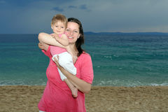 Mother with her baby at beach Stock Image