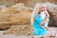 Mother with her baby on the beach Royalty Free Stock Photos