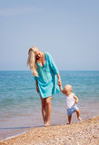 Mother with her baby on the beach Royalty Free Stock Photography