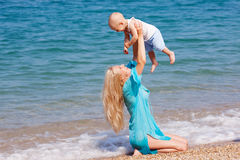 Mother with her baby on the beach Stock Image