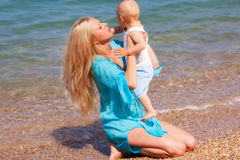 Mother with her baby on the beach Stock Photography