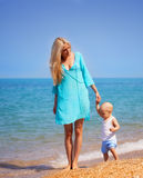 Mother with her baby on the beach Royalty Free Stock Image