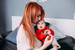 Mother with her baby in bedroom Royalty Free Stock Photo