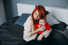 Mother with her baby in bedroom Royalty Free Stock Photos