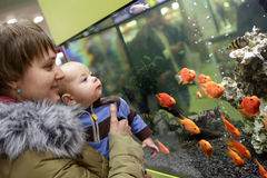 Mother with her baby boy at aquarium Royalty Free Stock Images