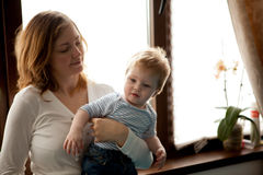 Mother with her baby boy looking at the window Royalty Free Stock Image