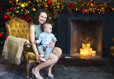 Mother with her baby boy near the Christmas tree Royalty Free Stock Photo