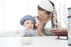 Mother and her baby boy with seashell. Royalty Free Stock Images
