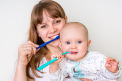 Mother and her baby brushing teeth together Royalty Free Stock Photo