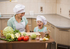 Mother with her baby chefs Royalty Free Stock Photography