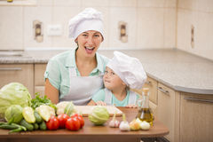 Mother with her baby chefs Stock Photos