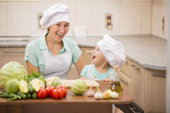 Mother with her baby chefs Stock Image
