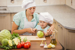 Mother with her baby chefs Stock Photography