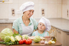 Mother with her baby chefs Royalty Free Stock Images