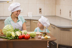 Mother with her baby chefs Stock Images