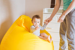 Mother and her baby child. Mom playing with laughing kid. Family at home Royalty Free Stock Photos