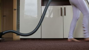 Mother with her baby clean apartment a vacuum cleaner stock footage