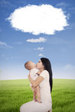 Mother and her baby with cloud speech Royalty Free Stock Images