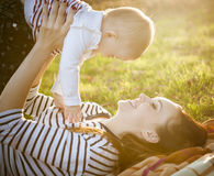 Mother with her baby daughter in autumn park Royalty Free Stock Photos