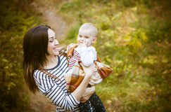 Mother with her baby daughter in autumn park Stock Image