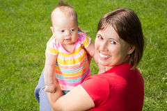 Mother and Her Baby Daughter Stock Images