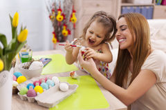 Mother and her baby during easter Stock Photos