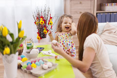 Mother and her baby during easter Stock Images