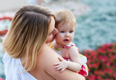 Mother and her baby enjoy the summer sunset Royalty Free Stock Photos