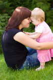 Mother and her baby in garden royalty free stock image