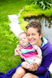 Mother with her baby have fun near the lake Stock Photos