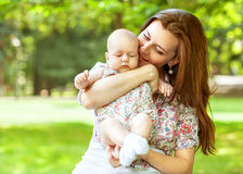 Mother and her baby outdoors Stock Image