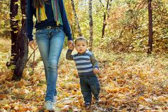 Young mother with her baby. Mother with her baby outdoors. walking mom and son in an autumn park Royalty Free Stock Photos