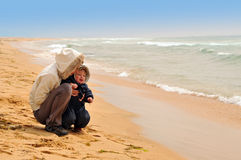 Mother with her baby on the sea beach Stock Photography