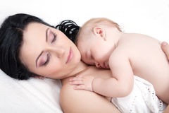 Mother and her baby, sleeping in bed Stock Image