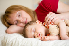 Mother and her baby sleeping together Royalty Free Stock Photography