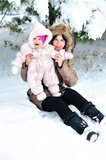 Mother with her baby in snow Royalty Free Stock Images