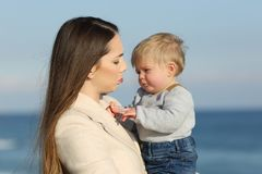 Mother and her baby son frowning outdoors Royalty Free Stock Photography