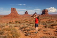 Mother with her baby son visit Oljato Monument Valley in Utah, U Stock Image