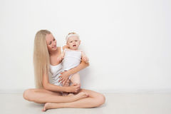 Mother with her baby studio shot Royalty Free Stock Photos